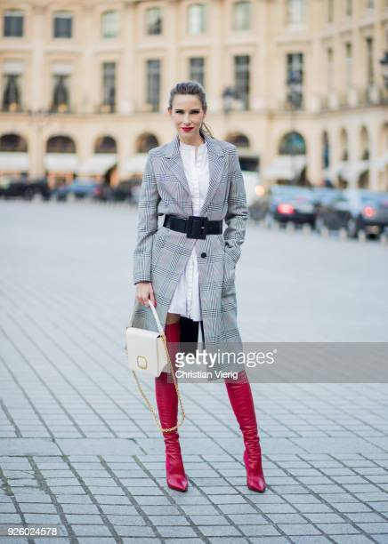 Alexandra Lapp wearing a grey and white checkered coat from Set Fashion red leather over knee boots from Fendi a white long shirt from Dorothee...
