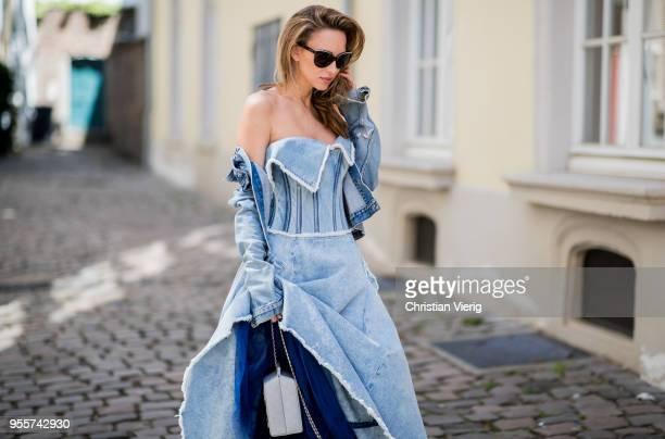 Alexandra Lapp wearing a light blue cotton strapless bustier denim dress by Natasha Zinko blue Levis denim jacket the Chanel Lait de coco milk carton...