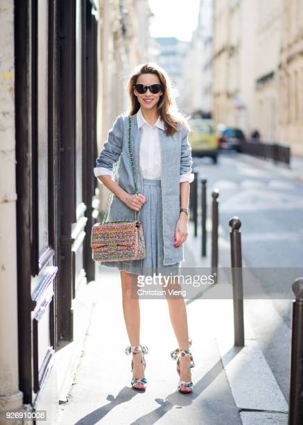 Alexandra Lapp wearing a linen open front blazer with a fringed hem line in a denim optic and a high waist linen pleated skirt in denim optic and a...