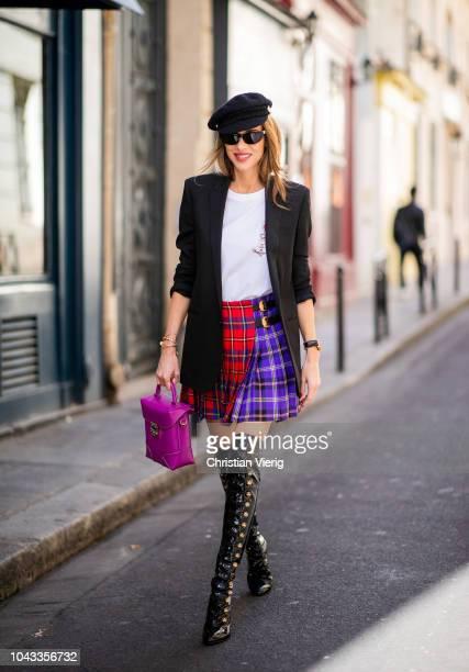 Alexandra Lapp wearing a long black boyfriend oversized blazer by Saint Laurent a handmade Wodka Ogurez TShirt with a handpainted print a pleated...