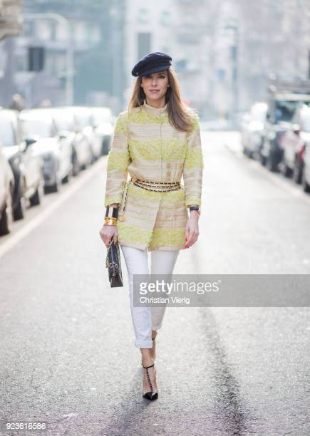 Alexandra Lapp wearing a long blazer with gold and yellow fringes and white summer pants from Airfield a vintage waist belt with chains and vintage...
