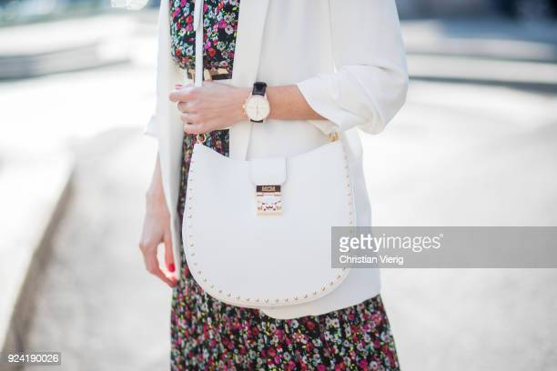 Alexandra Lapp wearing a long flower dress from HM silver shiny boots by HM a long white blazer from Zara a lacquer waist belt in white and black...
