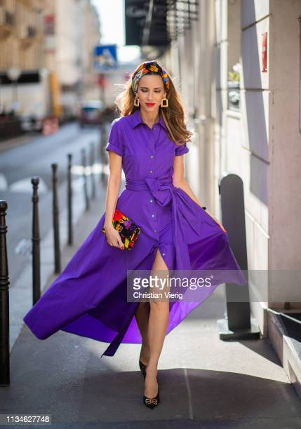 Alexandra Lapp wearing a long purple taffeta gown from PAROSH with a wide cut out leg multicolored silk scarf from Hermès the small BB clutch from...