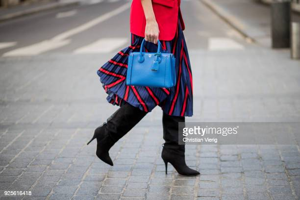 Alexandra Lapp wearing a long red blazer from Zara a silk top from Jadicted Collier de chien a black waist belt with a silver buckle from Hermes a...