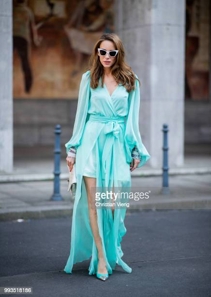 Alexandra Lapp wearing a long shine through dress in turquoise by Lana Mueller a 255 silver handbag by Chanel two tone Mahnolo Blahnik heels in...