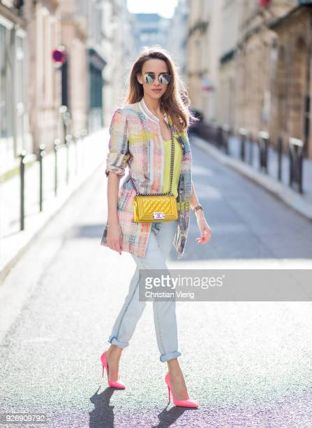 Alexandra Lapp wearing a long tweed blazer in pastel colors from Airfield a silk top in bright yellow from Jadicted light blue boyfriend jeans by...