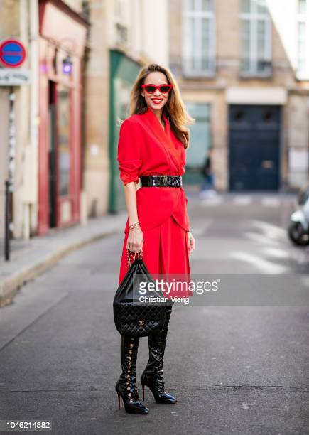 Alexandra Lapp wearing a long waisted blazer in red by Steffen Schraut red high waist skirt with attached belt by Steffen Schraut black patent...