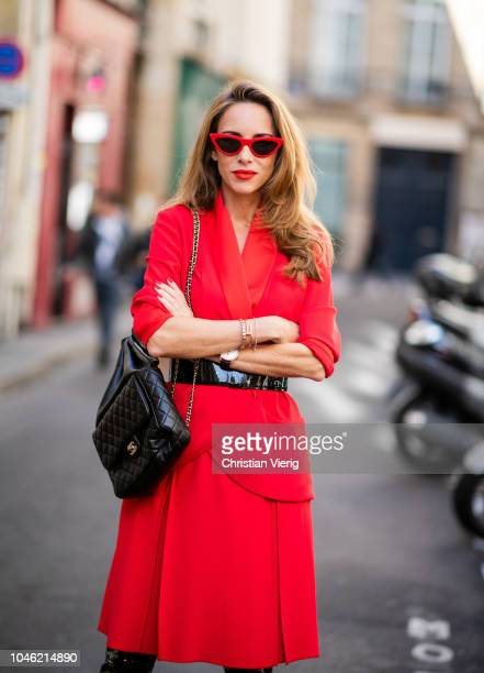 Alexandra Lapp wearing a long waisted blazer in red by Steffen Schraut red high waist skirt with attached belt by Steffen Schraut black patent...