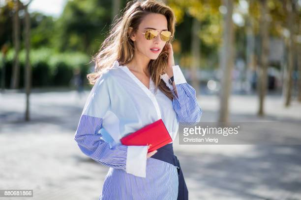 Alexandra Lapp wearing a multi striped blouse with different stripes from Steffen Schraut Aline skirt with blue and white stripes with a dark blue...