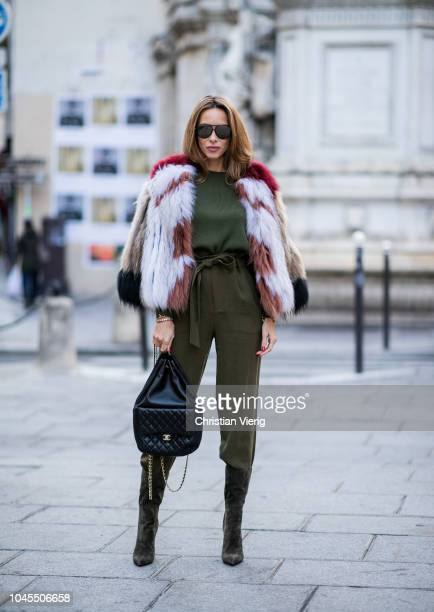 Alexandra Lapp wearing a multicolor short fur jacket from SET Fashion a slim cut Merino pullover in dark green from SET Fashion green culotte...