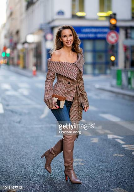 Alexandra Lapp wearing a plaid asymmetric off shoulder blazer from Monse dark blue jeans from Rag Bone over knee boots in soft pink from Santoni a...