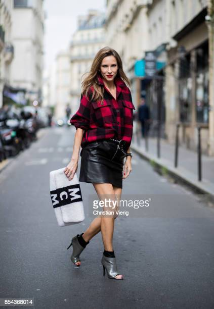 Alexandra Lapp wearing a plaid shirt by Set Fashion mini leather skirt and a leather belt with studs by Set oversized MCM Stark Pouch in lambskin...