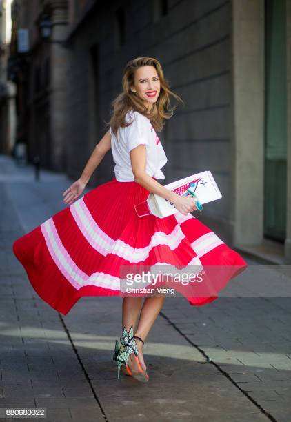 Alexandra Lapp wearing a pleated skirt from Valentino white tshirt from Valentino with label print written over the chest with red lipstick high heel...