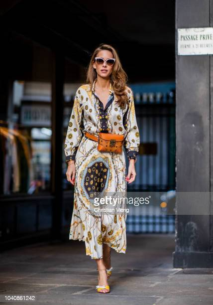 Alexandra Lapp wearing a pleating chain patchwork print skirt and a matching shirt from Zara a short fur jacket from Yves Salomon with an animal...