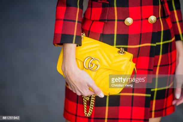 Alexandra Lapp wearing a red checked plaid wool blazerdress with golden buttons by Balmain ribbedknit Fendi thigh boots in red Rockoko leather a...