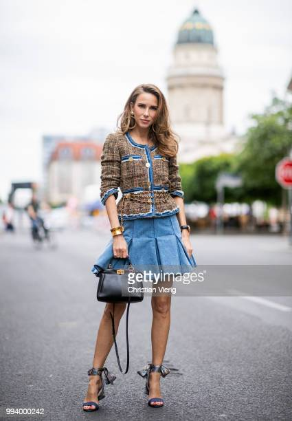 Alexandra Lapp wearing a short tweed boucle jacket with denim from Steffen Schraut a denim shirt from HM a denim pleated skirt from Balmain vintage...