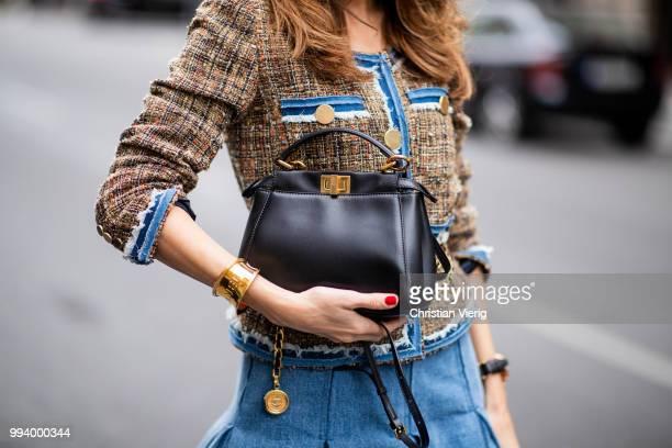 Alexandra Lapp wearing a short tweed boucle jacket with denim from Steffen Schraut a denim shirt from HM a denim pleated skirt from Balmain vintage...