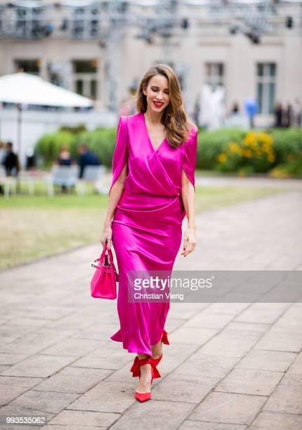 Alexandra Lapp wearing a silk dress in pink by Talbot Runhof red Douce Du Desert 100 Flamenco Satin sandals from Christian Louboutin with a long...