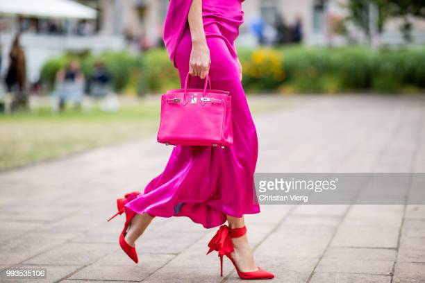 Alexandra Lapp wearing a silk dress in pink by Talbot Runhof red Douce Du Desert 100 Flamenco Satin sandals from Christian Louboutin with a long...