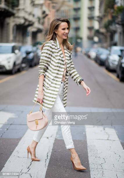 Alexandra Lapp wearing a striped long blazer in green and white and white pants with gold sprinkles from Airfield a camel tone satin top by Jadicted...