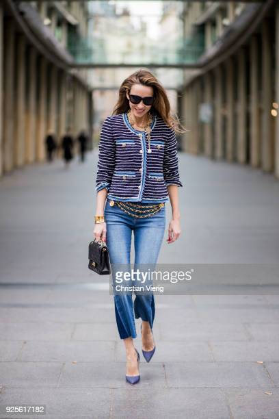 Alexandra Lapp wearing a striped tweed jacket in marine tones and flared jeans from Steffen Schraut a vintage belt with chains and vintage bracelets...