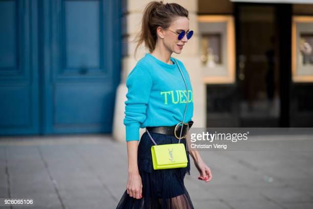 Alexandra Lapp wearing a turquoise pullover with a neon print Tuesday by Alberta Ferretti dress in black floral lace from SelfPortrait black waist...