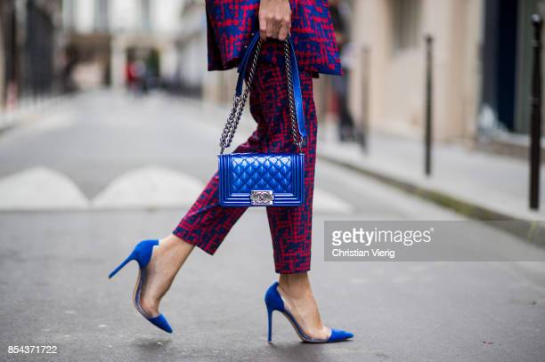 Alexandra Lapp wearing a twopiece in red and blue by Riani a blue lacquer Chanel Boy bag blue sunglasses by Etnia Barcelona plexi pumps in blue from...