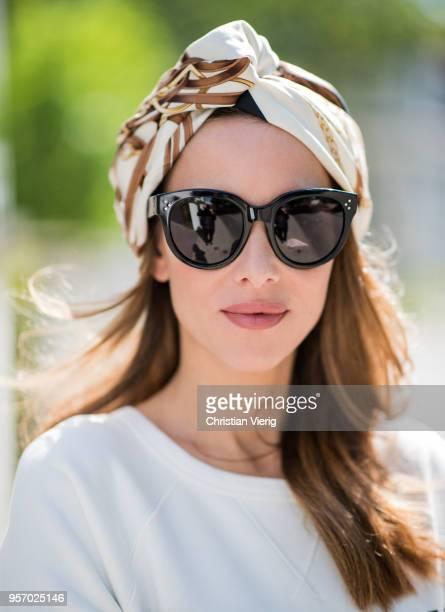 Alexandra Lapp wearing a white crewneck cotton sweatshirt by Gucci black double layered lace skirt by Zara the black GG Marmont matelasse belt bag in...