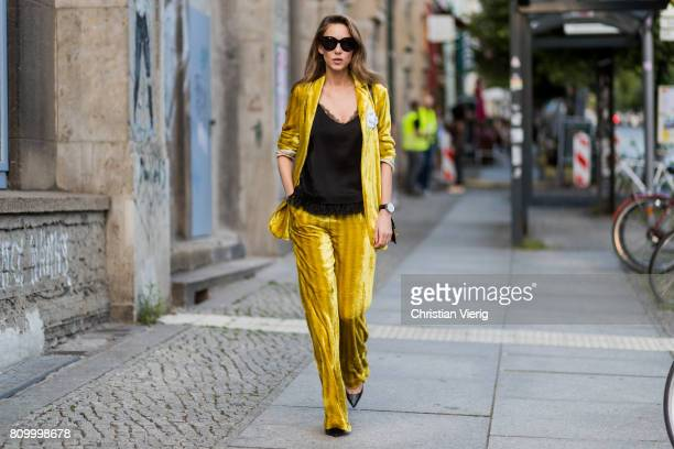 Alexandra Lapp wearing a yellow velvet Dorothee Schumacher suit during the MercedesBenz Fashion Week Berlin Spring/Summer 2018 at Kaufhaus Jandorf on...