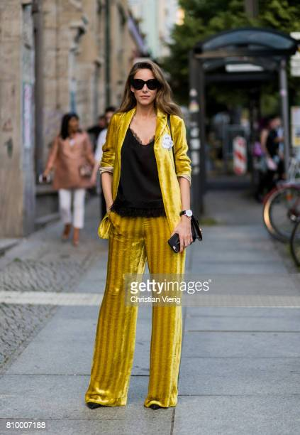Alexandra Lapp wearing a yellow velvet Dorothee Schumacher suit during the MercedesBenz Fashion Week Berlin Spring/Summer 2018 at Kaufhaus Jandorf on...