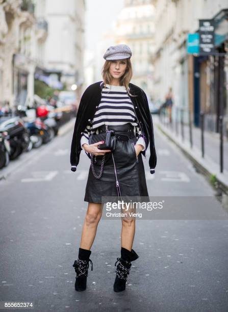 Alexandra Lapp wearing an Aline leather rocky biker skirt from SET Fashion striped knit jumper from Zara plaid Zara hat Isabel Marant slouchy boots...