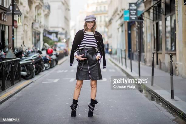 Alexandra Lapp wearing an Aline leather rocky biker skirt from SET Fashion striped knit jumper from Zara plaid Zara hat Isabel Marant slouchy boots...