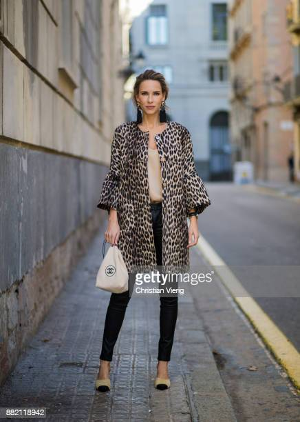 Alexandra Lapp wearing an animal printed jacket with voluminous bell sleeves by Steffen Schraut a straight cut silk top in light gold black skinny...