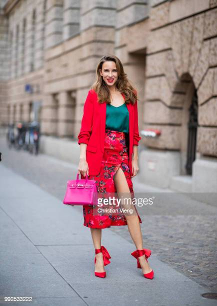 Alexandra Lapp wearing an Asian pencil skirt with a flower print from Zara a long red Blazer with cropped sleeves from Zara a green silk top from...