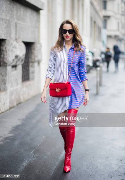 Alexandra Lapp wearing an asymmetric striped blouse by Offwhite red leather over knee boots from Fendi a red velvet Gucci Marmont handbag with a...