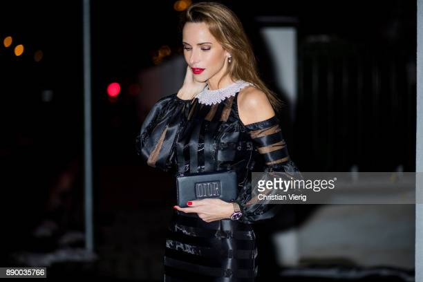 Alexandra Lapp wearing an evening dress from Zayan the label with pearled collar patent pumps from Christian Louboutin and clutch by Dior on December...