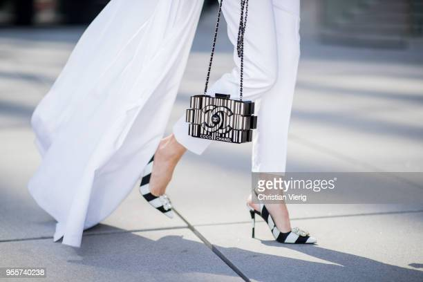 Alexandra Lapp wearing an offtheshoulder top with satin overlay in white and white straightleg satin pants from Pearl and Rubies a Chanel barcode...