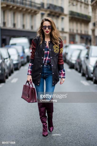 Alexandra Lapp wearing an oversized college jacket in leather from Set Fashion a plaid shirt with studs from Set high waist skinny jeans by Rag and...