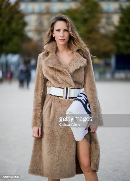 Alexandra Lapp wearing an oversized MCM Stark Pouch in Shearling Stripe a lambskin coat in light brown by Yves Salomon black and white big waistbelt...