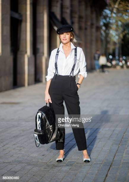 Alexandra Lapp wearing black and white vintage Chanel suspenders with Chanel logo in black and white, a white oversized shirt from Steffen Schraut,...