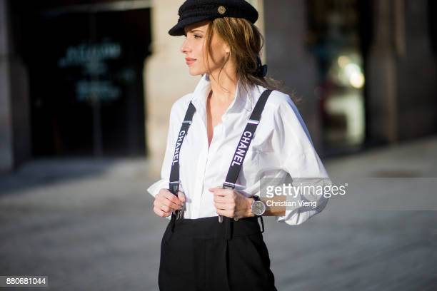 Alexandra Lapp wearing black and white vintage Chanel suspenders with Chanel logo in black and white a white oversized shirt from Steffen Schraut...