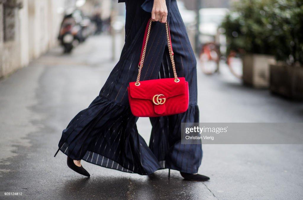 Street Style: February 24 - Milan Fashion Week Fall/Winter 2018/19 : News Photo