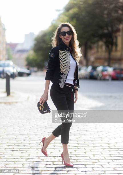 Alexandra Lapp wearing black skinny pants white knit top band jacket Noelia and Crossbody bag in black with Swarovski crystals from La Martina...