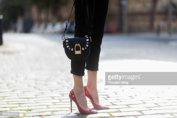 Alexandra Lapp wearing black skinny pants white knit top band jacket Noelia and Crossbody bag in black with Swarovski crystals from La Martina...