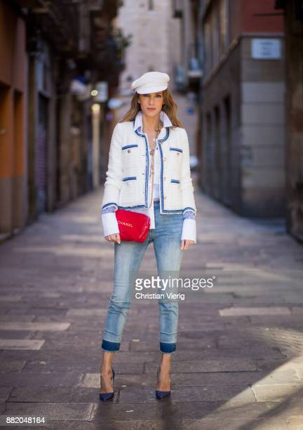 Alexandra Lapp wearing blue cropped jeans by Steffen Schraut, a white cotton shirt with different shades of blue stripes, a classic navy-white blazer...