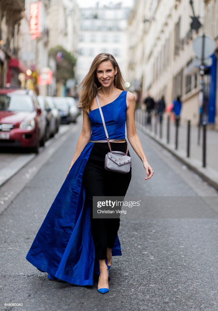 Alexandra Lapp wearing Blue taffeta and leather top from Pearl and Rubies with a skin barring asymmetric one-shoulder Silhouette, Black pants from Pearl and Rubies, Blue suede Plexi pumps from Gianvito Rossi, Catherine shoulder mini bag from MCM on March 4, 2017 in Paris, France.