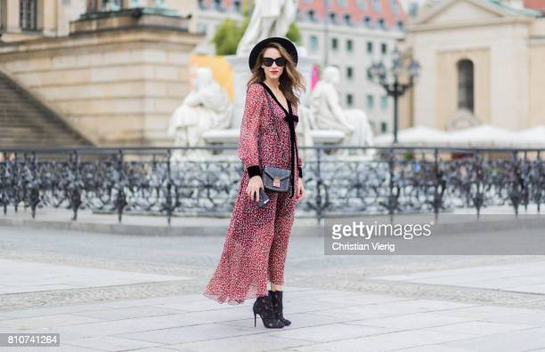 Alexandra Lapp wearing Boho Style, a red and cream floral print maxi dress from Philosophy di Lorenzo Serafini in sheer silk chiffon and bold black...