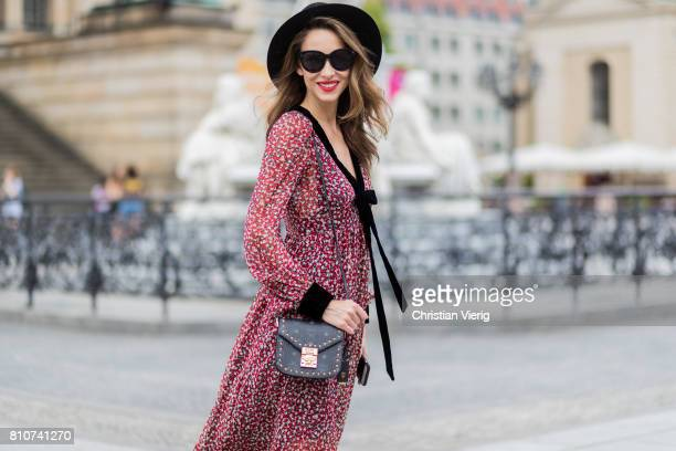 Alexandra Lapp wearing Boho Style a red and cream floral print maxi dress from Philosophy di Lorenzo Serafini in sheer silk chiffon and bold black...