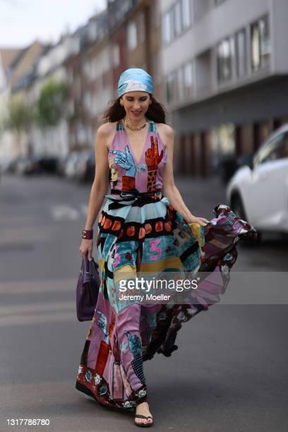 Alexandra Lapp wearing colorful Valentino dress, black Bottega Veneta sandals, purple Hermès Kelly bag and blue Hermès scarf, gold Dior necklace and...