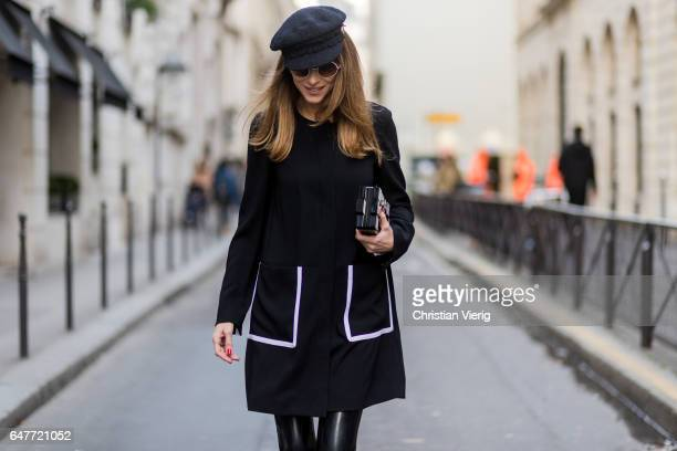 Alexandra Lapp wearing Couture Latex socks Atsuko Kudo coat Steffen Schraut Pumps Saint Laurent Cap Chanel Bag Chanel Lego Brique bag in black and...